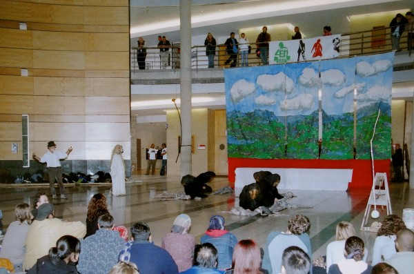 """The Bread and Puppet Theater group from Vermont performed at Vari Hall on November 8, 2005. The group was invited by the York Federation of Students in its fight """"for more student space on increasingly corporatized Canadian University campuses."""" The posters attached to the railing on the second floor level read """"This is my space."""" Photo courtesy Deborah Barndt"""