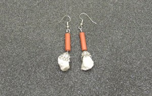 The ear-rings were made from ramp rubble by Faculty of Arts student enrolment advisor Karen Hecker. Objects held at York Libraries, Clara Thomas Archives and Special Collection. Photo courtesy the author.