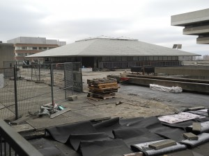 The Scott Religious Centre a gray December day in 2014 surrounded by construction material used to patch the leaking floor of the terrace. Photo courtesy the author.