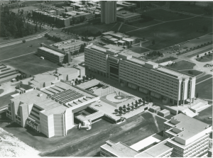 An oblique air photograph of the York University showing the Ross Building terrace as the central focus of the campus. Photo courtesy of York University Libraries, Clara Thomas Archives and Special Collection, AC19501.