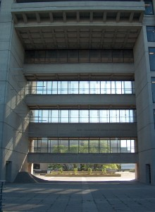 """The """"primordial temple front"""" of the Ross Building. The statement of Murray Ross is located at the bottom concrete bar which is part of glass-walled corridors that connect the south and north end of the building. Photo courtesy the author."""